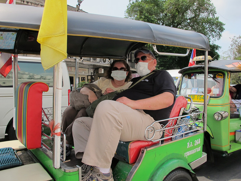 Ellis and Renee Mirsky modeling surgical face masks while seated in a Tuk-Tuk in Bangkok.