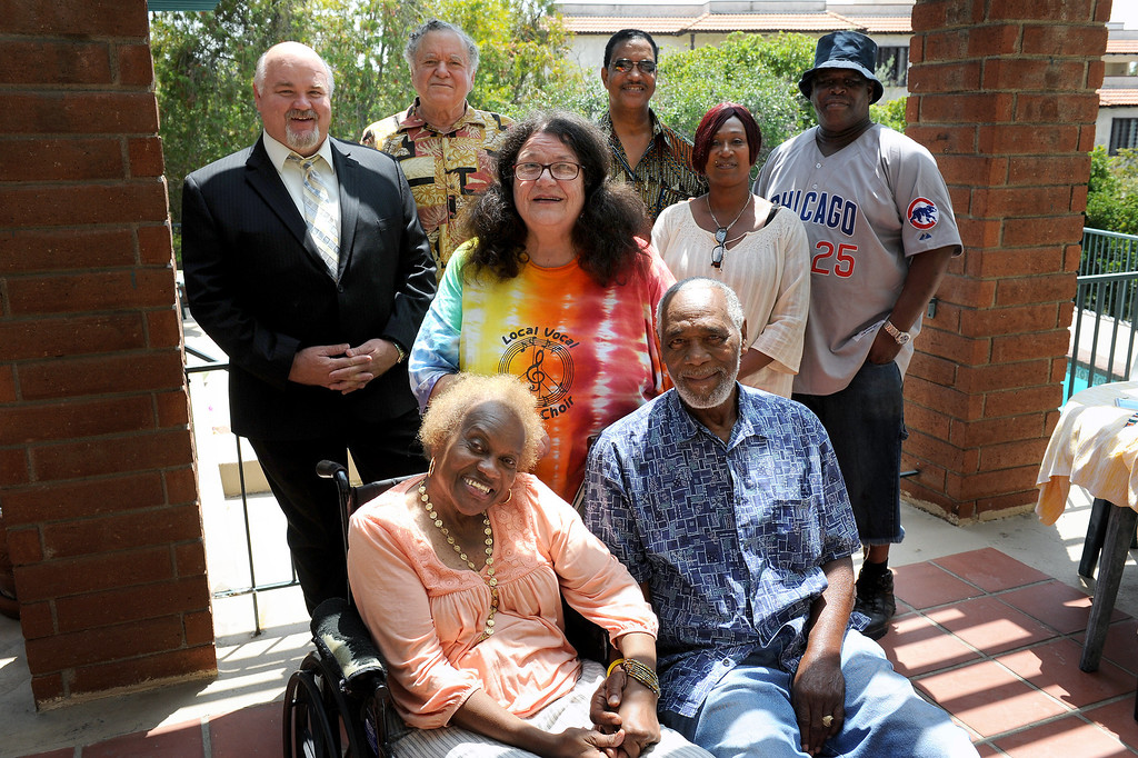 . Ralph Brissette, front right, who is the lone survivor of the 1971 Sylmar water tunnel explosion that killed 17 miners, sits with wife Sharon Evans-Brissette, front left, and supporters, back from left, Sylmar Neighborhood Council President Don Neal, Peter Rosenwald, Sharon Cotrell, Dwight Bonds, Chizoma Fears and Kenneth Wyrick. (Michael Owen Baker/Staff Photographer)