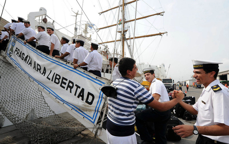 . Crew members of the Argentine naval vessel ARA Libertad board the ship at Tema harbour in Accra December 19, 2012. The Argentine naval vessel detained in Ghana at the request of a hedge fund seeking payment on defaulted government bonds left the West African country on Wednesday, a port official said. The ARA Libertad, a tall sailing ship used for training, was detained on a court order obtained by NML Capital Ltd, which claims it is owed $300 million from Argentina\'s default in 2002. REUTERS/Handout