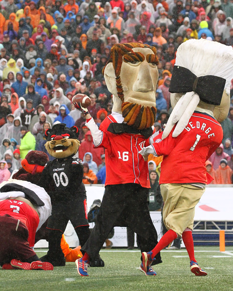 Abe Lincoln carries the ball into the endzone for a Nationals touchdown as George Washington leads the way.