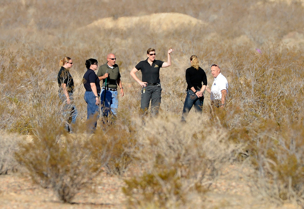 . San Bernardino County Sheriff detectives investigate a scene off of Quarry Road, near Interstate 15, in the desert north of Victorville Wednesday morning November 13, 2013 after multiple skelton remains were found. The investigation is on going.   (Will Lester/Inland Valley Daily Bulletin)