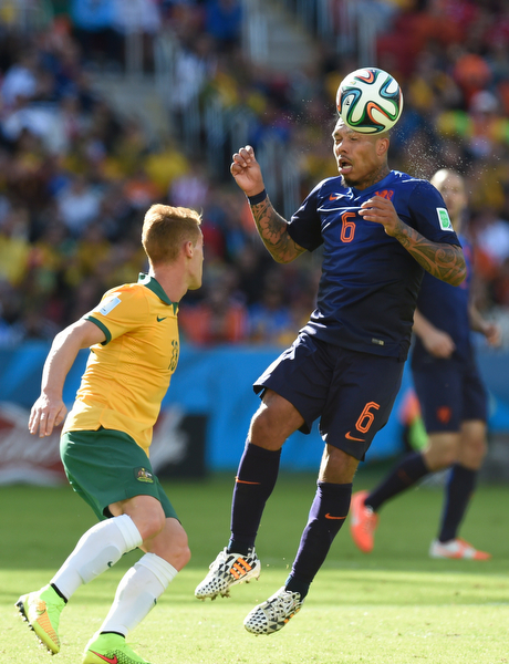 . Netherlands\' midfielder Nigel de Jong (R) vies with Australia\'s midfielder Oliver Bozanic during a Group B football match between Australia and the Netherlands at the Beira-Rio Stadium in Porto Alegre during the 2014 FIFA World Cup on June 18, 2014. (JUAN BARRETO/AFP/Getty Images)