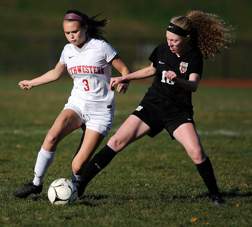 10/23/2019 MIke Orazzi | StaffrTerryville's Zoe Zappone (18) and Northwestern's Ally Danilla (3) during girls soccer at Terryville High School on Wednesday.