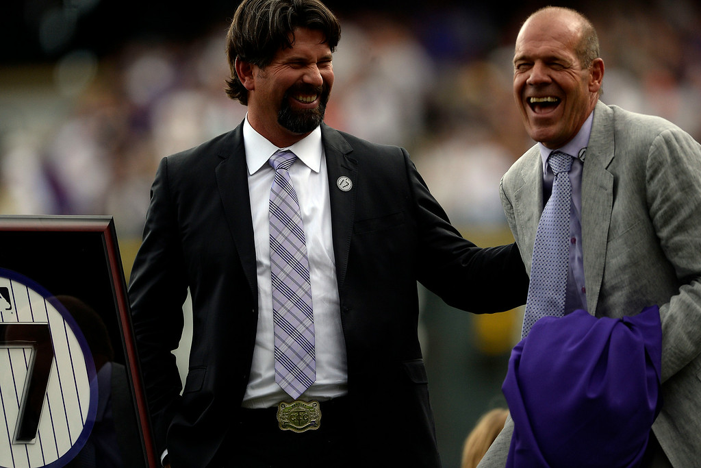 . Colorado Rockies great Todd Helton stands with a replica of his retired number 17 as he jokes with owner Charlie Monfort during a retirement ceremony held in his honor. Helton, who played 17 season with the Rockies and holds records for many of the organizations career statistics, was honored on Sunday, August 17, 2014. (Photo by AAron Ontiveroz/The Denver Post)