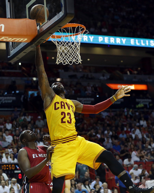 . Cleveland Cavaliers forward LeBron James (23) shoots over Miami Heat forward Luol Deng during the first half of an NBA basketball game, Saturday, March 19, 2016, in Miami. (AP Photo/Lynne Sladky)