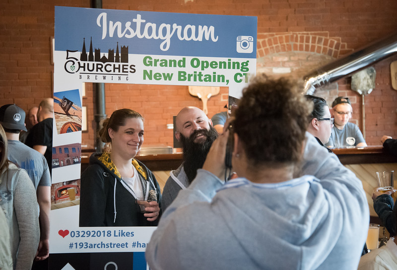 03/30/18  Wesley Bunnell | Staff  5 Churches Brewing held their ribbon cutting with city officials on Friday at noon to a crowd of customers lined down the sidewalk.  Kirsten Ringsted poses for an Instagram photos with Jason Fontain as its taken by 5 Church's media consultant Melissa Jones.