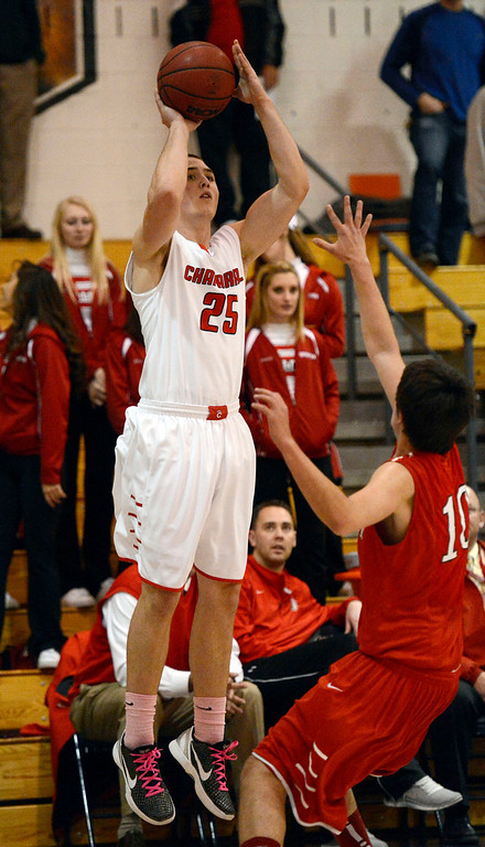 . Chaparral\'s Wil Keyser (25) takes a shot over Brighton\'s Jaren Snyder (10) February 27, 2013. (Photo By John Leyba/The Denver Post)
