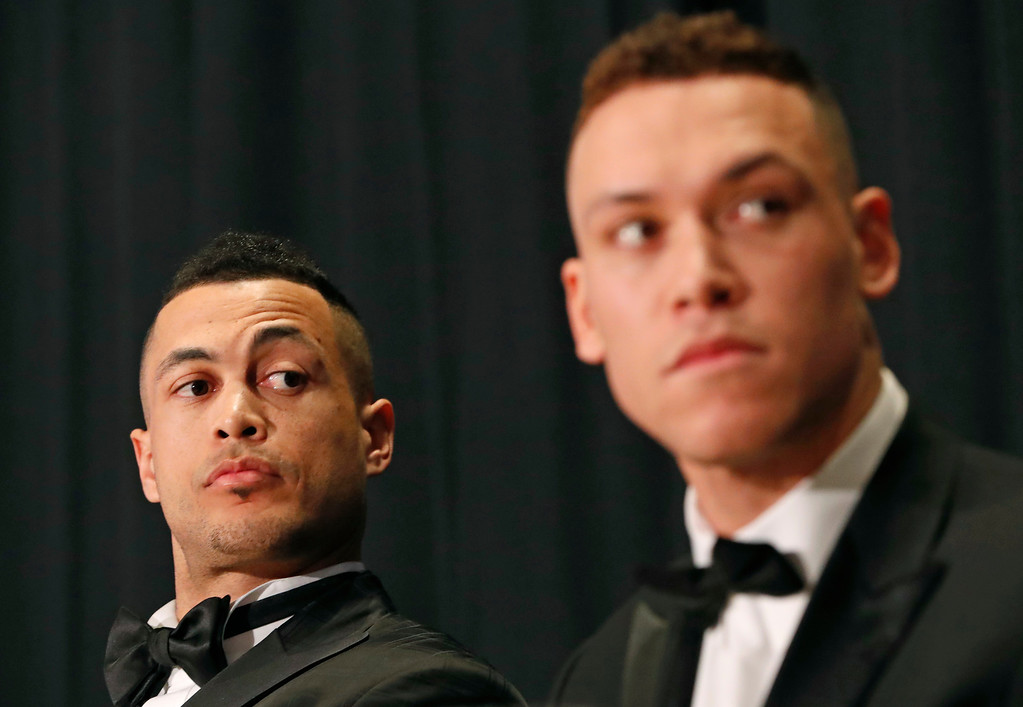 . National League Most Valuable Player Giancarlo Stanton, left, and American League Rookie of the Year Aaron Judge listen to speakers during the New York Chapter of the Baseball Writers\' Association of America annual dinner in New York, Sunday, Jan. 28, 2018, where both picked up their awards. (AP Photo/Kathy Willens)