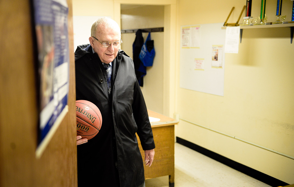 . Chisholm boys basketball coach Bob McDonald grabs a ball before leaving his office and hopping on a bus with his team to nearby Nashwauk-Keewatin for a matchup. He recently won his 1,000th game and is retiring after this season. (Pioneer Press: Ben Garvin)