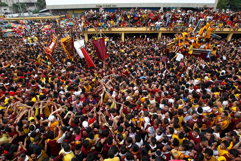 . Devotees struggle to hold the rope that pulls the carriage of the Black Nazarene during a procession in Manila January 9, 2013. The Black Nazarene, a life-size wooden statue of Jesus Christ carved in Mexico and brought to the Philippines in the 17th century, is believed to have healing powers in the predominantly Roman Catholic country. It is paraded through the narrow streets of Manila\'s old city from dawn to midnight. Police said about 500,000 people joined the procession on Wednesday. REUTERS/Romeo Ranoco