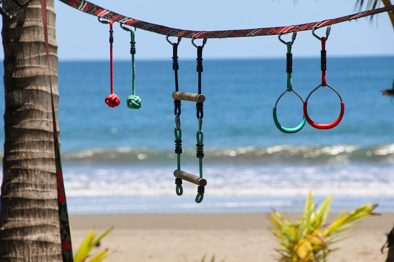 swings and excercise set on the beach