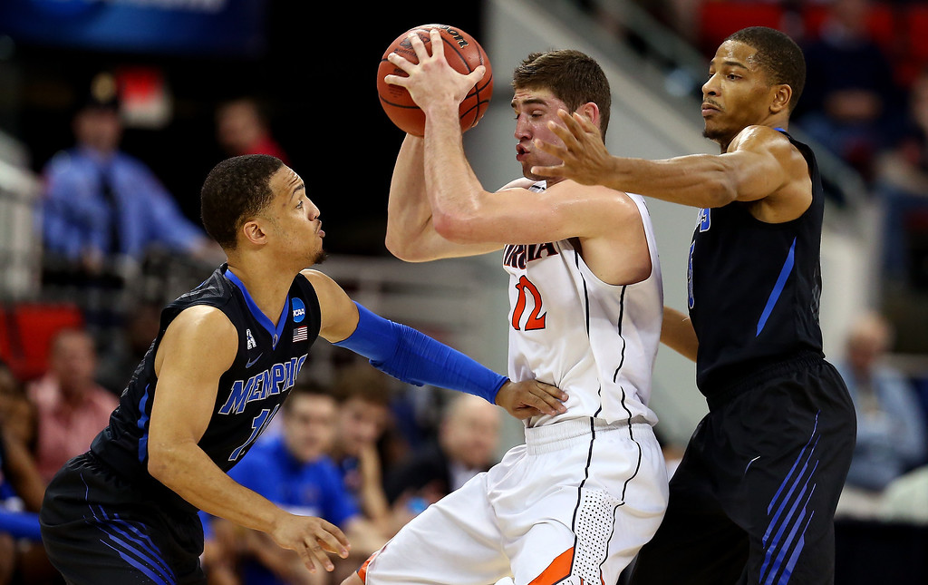 . Joe Harris #12 of the Virginia Cavaliers handles the ball against mm11#@ and Nick King #5 of the Memphis Tigers in the second half during the third round of the 2014 NCAA Men\'s Basketball Tournament at PNC Arena on March 23, 2014 in Raleigh, North Carolina.  (Photo by Streeter Lecka/Getty Images)