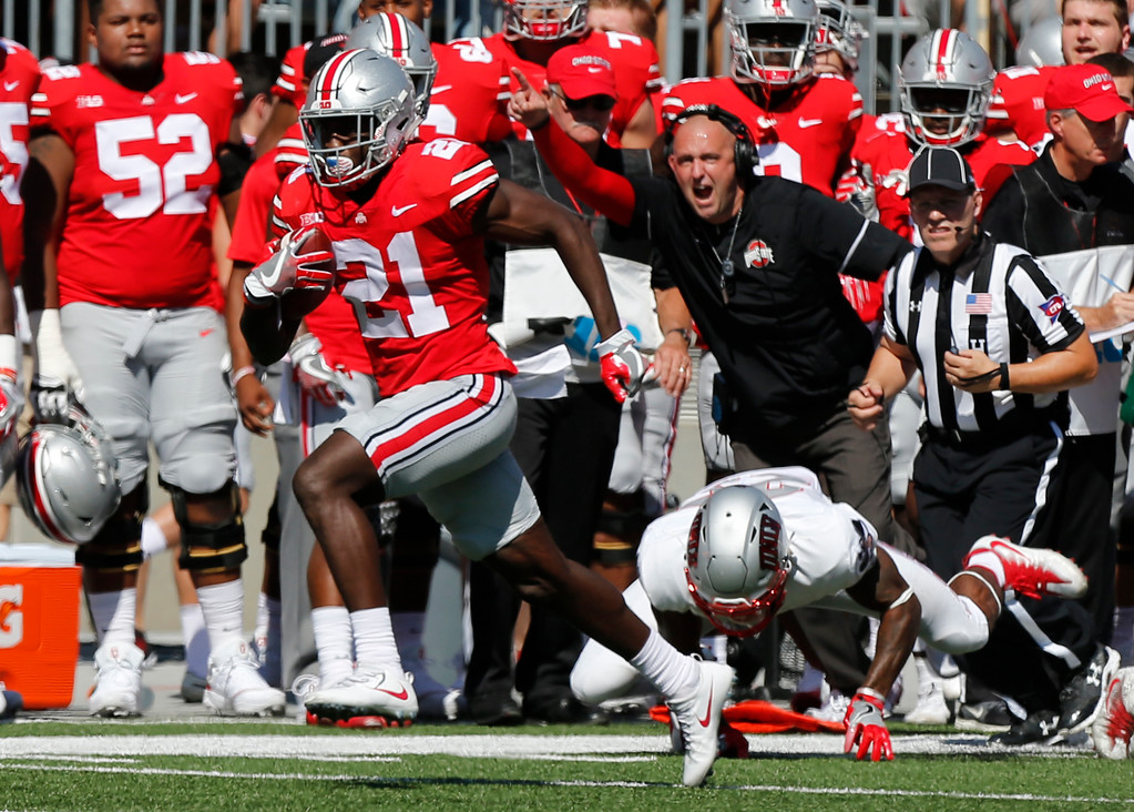 . Ohio State receiver Parris Campbell, left, escapes the grasp of UNLV linebacker Gabe McCoy on his way to scoring a touchdown during the first half of an NCAA college football game Saturday, Sept. 23, 2017, in Columbus, Ohio. (AP Photo/Jay LaPrete)