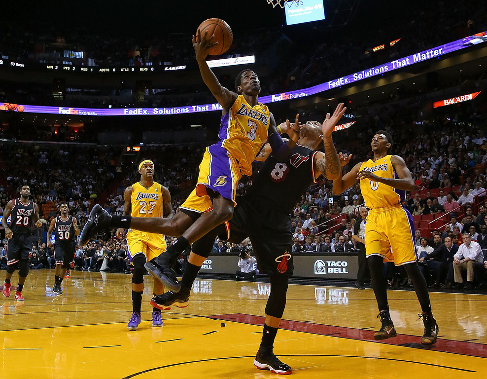 . Manny Harris #3 of the Los Angeles Lakers drives on Rashard Lewis #9 of the Miami Heat during a game  at American Airlines Arena on January 23, 2014 in Miami, Florida.  (Photo by Mike Ehrmann/Getty Images)