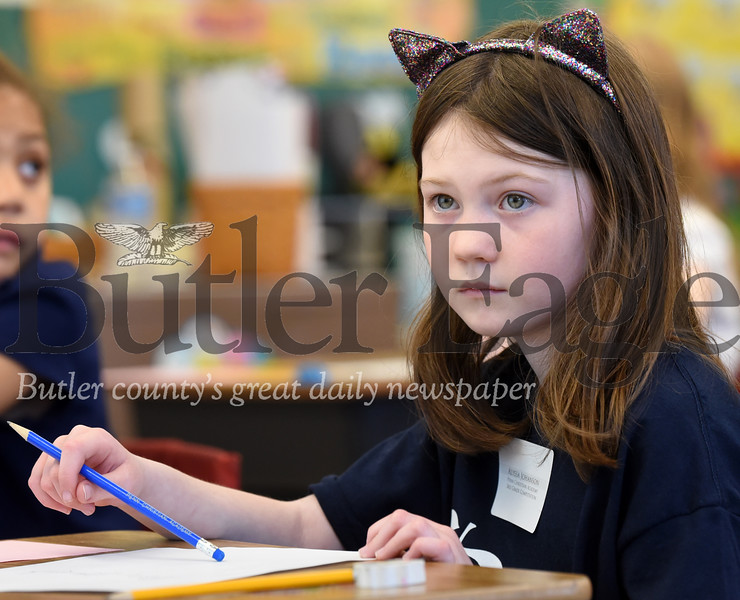 Harold Aughton/Butler Eagle:Alyssa Johanson, 9, a 3rd grader at Penn Christian Academy listens intently to the instructions prior to the compuation part of the test.