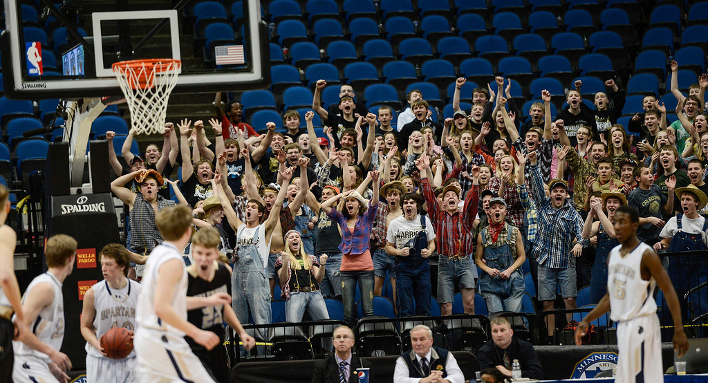 . Fans cheer after Caledonia\'s West Spier slam dunks the ball during the second half. (Special to the Pioneer Press: Matt Mead)