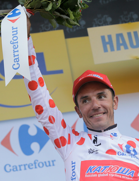 . Spain\'s Joaquim Rodriguez, wearing the best climber\'s dotted jersey, celebrates on the podium of the tenth stage of the Tour de France cycling race over 161.5 kilometers (100.4 miles) with start in Mulhouse and finish in La Planche des Belles Filles, France, Monday, July 14, 2014. (AP Photo/Laurent Cipriani)
