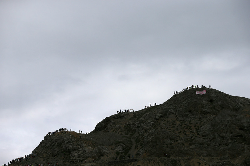 . Spectators line up on the crest of Izoard pass to watch the cyclist down below during the fourteenth stage of the Tour de France cycling race over 177 kilometers (110 miles) with start in Grenoble and finish in Risoul, France, Saturday, July 19, 2014. (AP Photo/Laurent Cipriani)