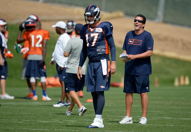 . Denver Broncos quarterbacks coach Greg Knapp laughs out during drills as Denver Broncos quarterback Brock Osweiler (17) prepares for the snap during practice August 26, 2014 at Dove Valley.(Photo by John Leyba/The Denver Post)