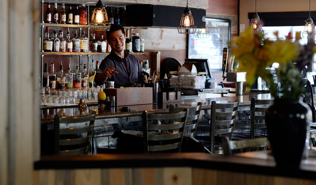 """. DENVER, CO - APRIL 21:  Bar tender Nate Leong at  Grind Kitchen + Watering Hole in Cherry Creek North  in Denver on Thursday, April 21, 2016.  Leong made a a \""""Desperado\"""" cocktail later in the morning.  (Photo by Cyrus McCrimmon/ The Denver Post)"""