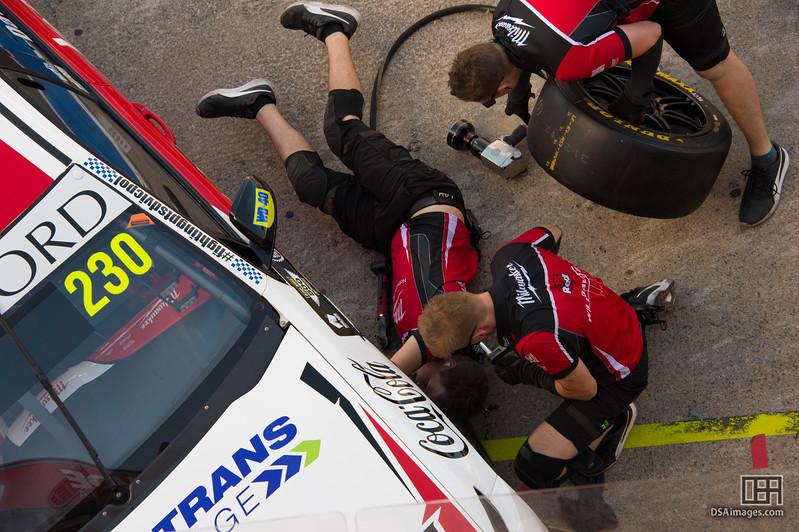 Running repairs on Will Davison's car