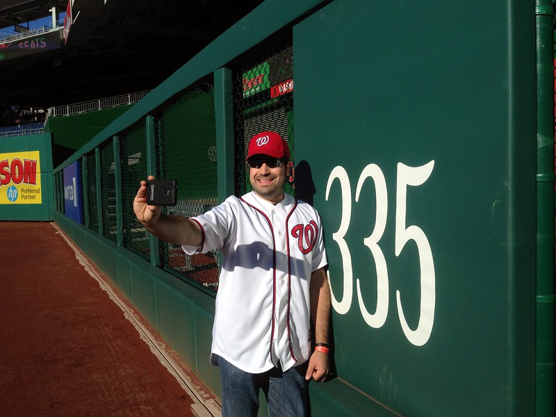 Craig takes a selfie at the outfield wall (photo by Jenni Simmons)