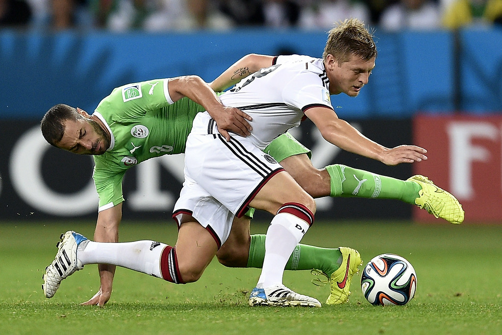 . Algeria\'s midfielder Medhi Lacen (L) vies with Germany\'s midfielder Toni Kroos during a Round of 16 football match between Germany and Algeria at Beira-Rio Stadium in Porto Alegre during the 2014 FIFA World Cup on June 30, 2014.  Lucas Uebel/AFP/Getty Images