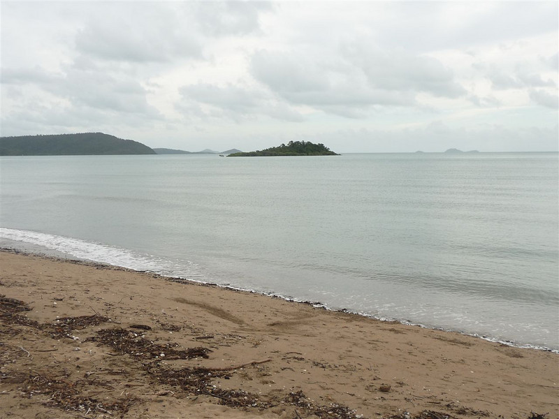 Cannonvale Beach to the northwest. Pigeon Reef at the front, and Double Cone Islands in the background on the right.