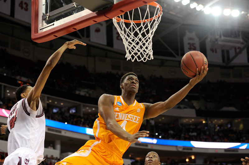 . Armani Moore #4 of the Tennessee Volunteers goes up for a shot against the Massachusetts Minutemen in the second round of the 2014 NCAA Men\'s Basketball Tournament at PNC Arena on March 21, 2014 in Raleigh, North Carolina.  (Photo by Grant Halverson/Getty Images)