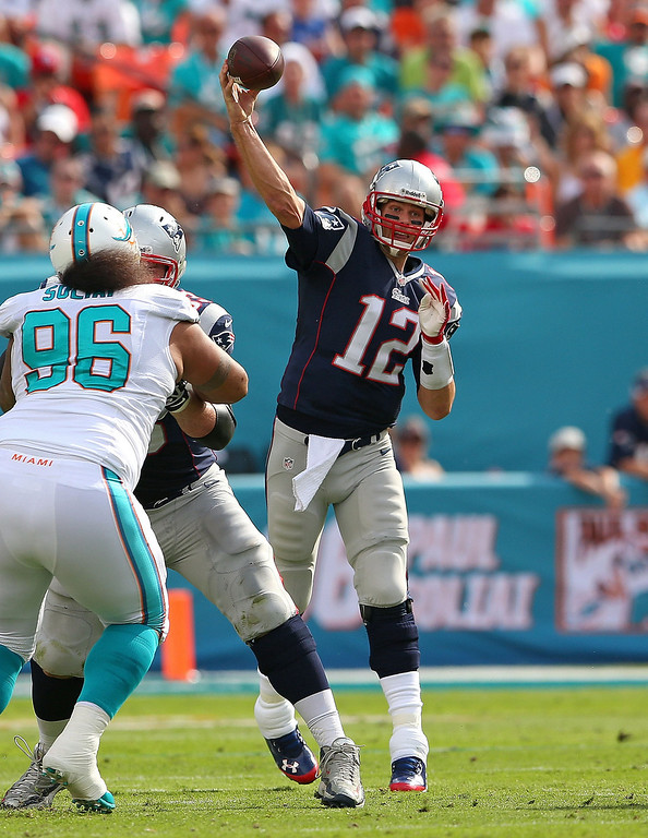 . Tom Brady #12 of the New England Patriots passes during a game against the Miami Dolphins at Sun Life Stadium on December 15, 2013 in Miami Gardens, Florida.  (Photo by Mike Ehrmann/Getty Images)