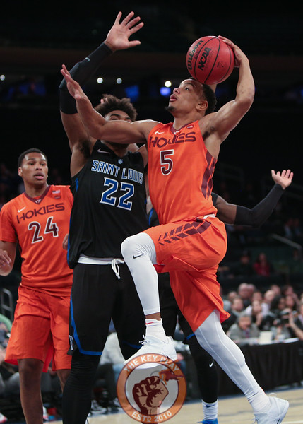 Virginia Tech's guard Justin Robinson (5) goes for a lay up over St. Louis' forward Hasahn French (22) in Madison Square Garde, Nov. 16, 2017. St. Louis upset Virginia Tech with a 77-71 win.
