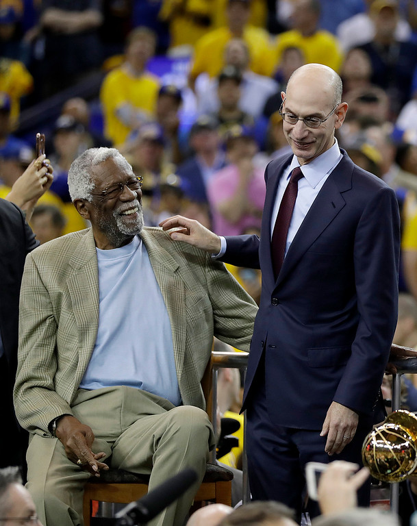 . Bill Russell, left, laughs he talks with NBA Commissioner Adam Silver after Game 5 of basketball\'s NBA Finals between the Golden State Warriors and the Cleveland Cavaliers in Oakland, Calif., Monday, June 12, 2017. The Warriors won 129-120 to win the NBA championship. (AP Photo/Marcio Jose Sanchez)