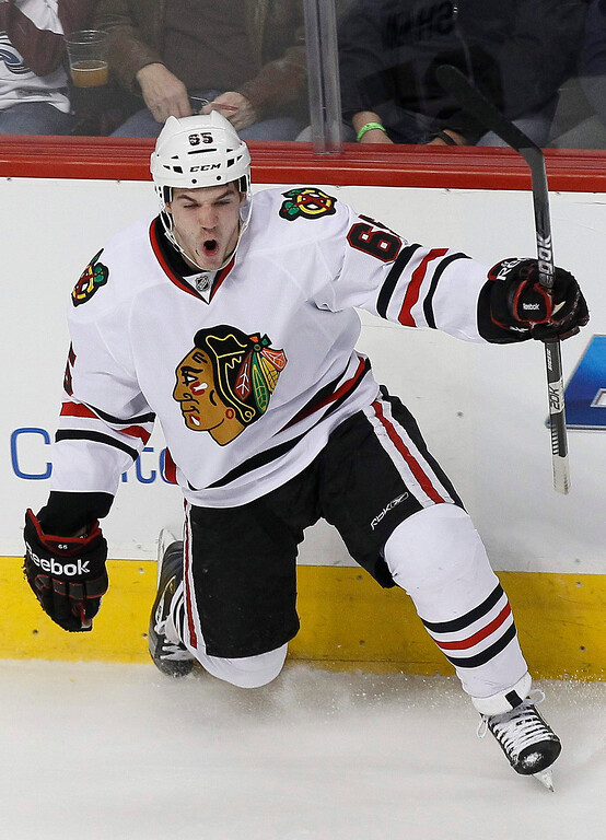 . Chicago Blackhawks\' Andrew Shaw celebrates scoring a first period goal past the Colorado Avalanche in their NHL hockey game in Denver March 18, 2013. REUTERS/Rick Wilking