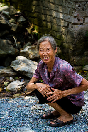 Lovely older woman in the beautiful northern Vietnam countryside near Tam Coc.