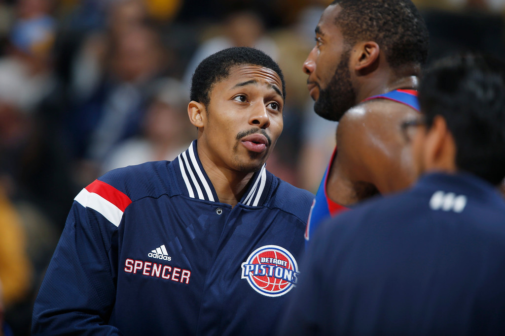 . Detroit Pistons rookie guard Spencer Dinwiddie, left, who was drafted this year from the University of Colorado, confers with center Andre Drummond during a time out against the Denver Nuggets in the third quarter of the Nuggets\' 89-79 victory in an NBA basketball game in Denver on Wednesday, Oct. 29, 2014. (AP Photo/David Zalubowski)
