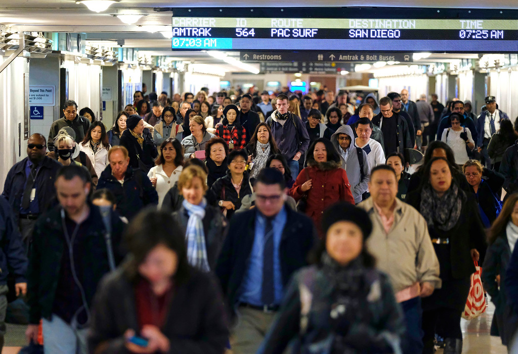 . Railroad travelers and commuters make their way through Union Station in downtown Los Angeles on Wednesday, Nov. 23, 2016. As tens of millions of Americans take to the roads, airports and railways for the Thanksgiving holiday, many are hoping to take a break from the rancor and division of the presidential election and focus instead on family and tradition. (AP Photo/Richard Vogel)