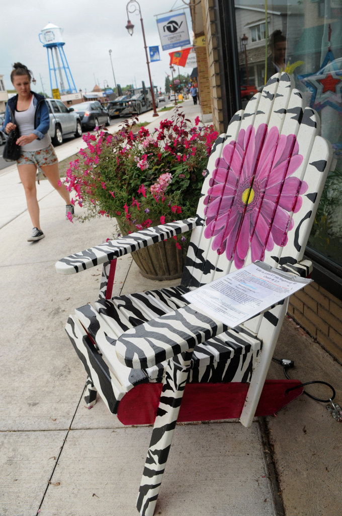 """. \""""Petals & Stripes\"""", painted by by Donyal Eret, sits in downtown Linstrom in hopes of attracting new business to the communityon Friday July 26, 2013. (Pioneer Press: Jean Pieri)"""