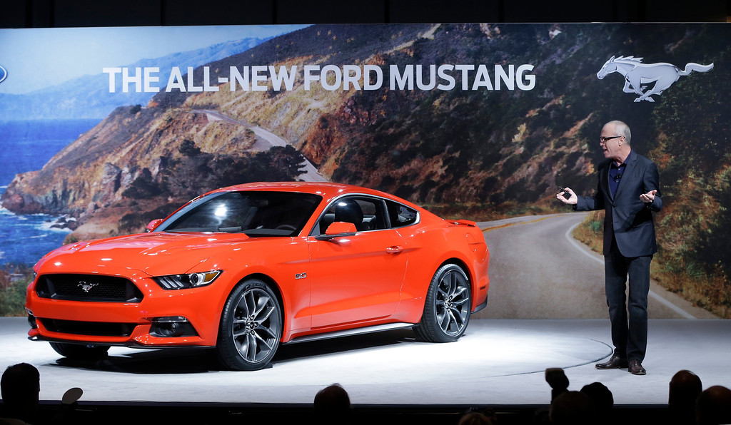 . J Mays, Ford\'s global design chief, describes the features on the automaker\'s new 2015 Ford Mustang in Dearborn, Mich., Thursday, Dec. 5, 2013. (AP Photo/Carlos Osorio)