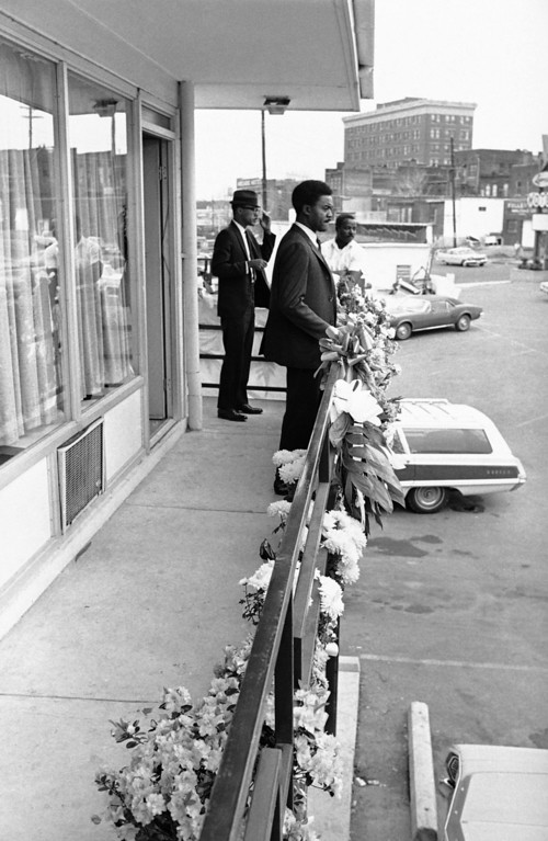 . Floral pieces line the rail outside the room that Dr. Martin Luther King occupied in a motel in Memphis, Tennessee, April 7, 1968. It was outside this room while leaning on the rail that Dr. King was struck and killed by a sniper\'s bullet on Thursday. An unidentified staff member looks out over the flowers and the direction of the shot.  (AP Photo)