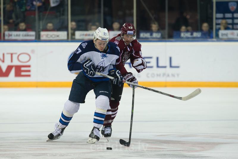Pavel Kulikov (17) stops offence of Tim Sestito (43) of Dinamo Riga