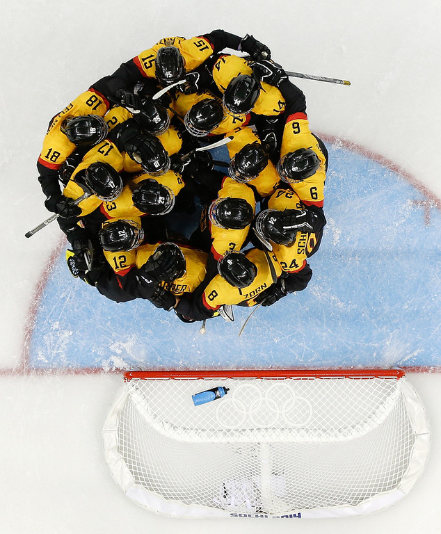 . Members of Team Germany celebrate their 3-2 win over Japan in the 2014 Winter Olympics women\'s ice hockey game at Shayba Arena, Tuesday, Feb. 18, 2014, in Sochi, Russia. (AP Photo/Matt Slocum)