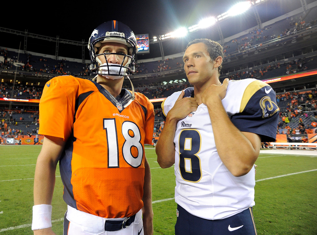 . DENVER, CO. - AUGUST 17: Denver Broncos quarterback Peyton Manning (18) talks with St. Louis Rams quarterback Sam Bradford (8) after the game August 24, 2013 at Sports Authority Field at Mile High. (Photo By John Leyba/The Denver Post)
