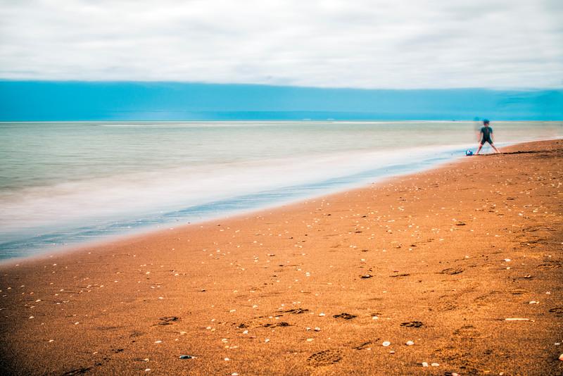 Kid on the beach, long exposure shot.