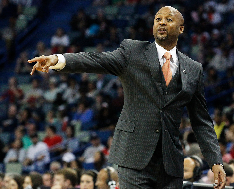 . Denver Nuggets head coach Brian Shaw talks to his team in the first half of an NBA basketball game against the New Orleans Pelicans in New Orleans, Sunday, March 9, 2014. (AP Photo/Bill Haber)