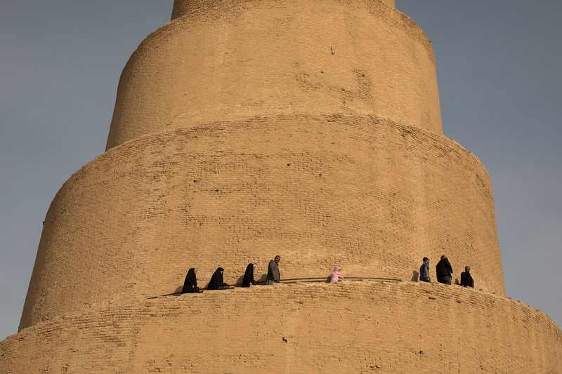 Iraqi's climbing the spiralling steps of the Malwiya Minaret.
