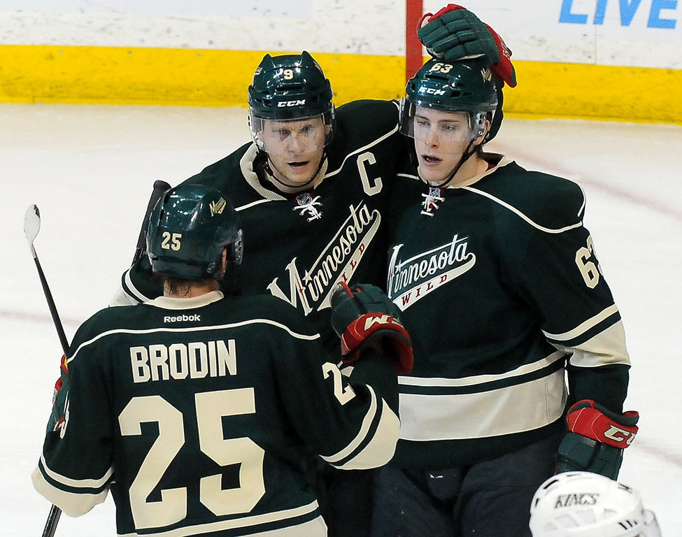 . Minnesota\'s Jonas Brodin, front; Mikko Koivu, middle; and Charlie Coyle, right, celebrate Coyle\'s goal during the second period. (Pioneer Press: Sherri LaRose-Chiglo)