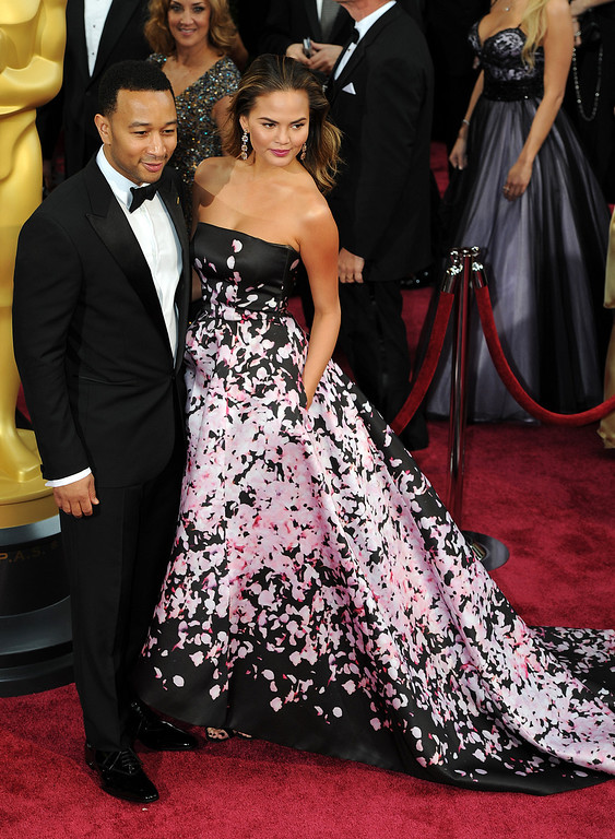 . John Legend and Christine Teigen attend the 86th Academy Awards at the Dolby Theatre in Hollywood, California on Sunday March 2, 2014 (Photo by John McCoy / Los Angeles Daily News)