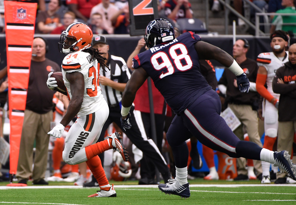 . Cleveland Browns running back Isaiah Crowell (34) runs the ball as Houston Texans defensive tackle D.J. Reader (98) gives chase in the first half of an NFL football game, Sunday, Oct. 15, 2017, in Houston. (AP Photo/Eric Christian Smith)