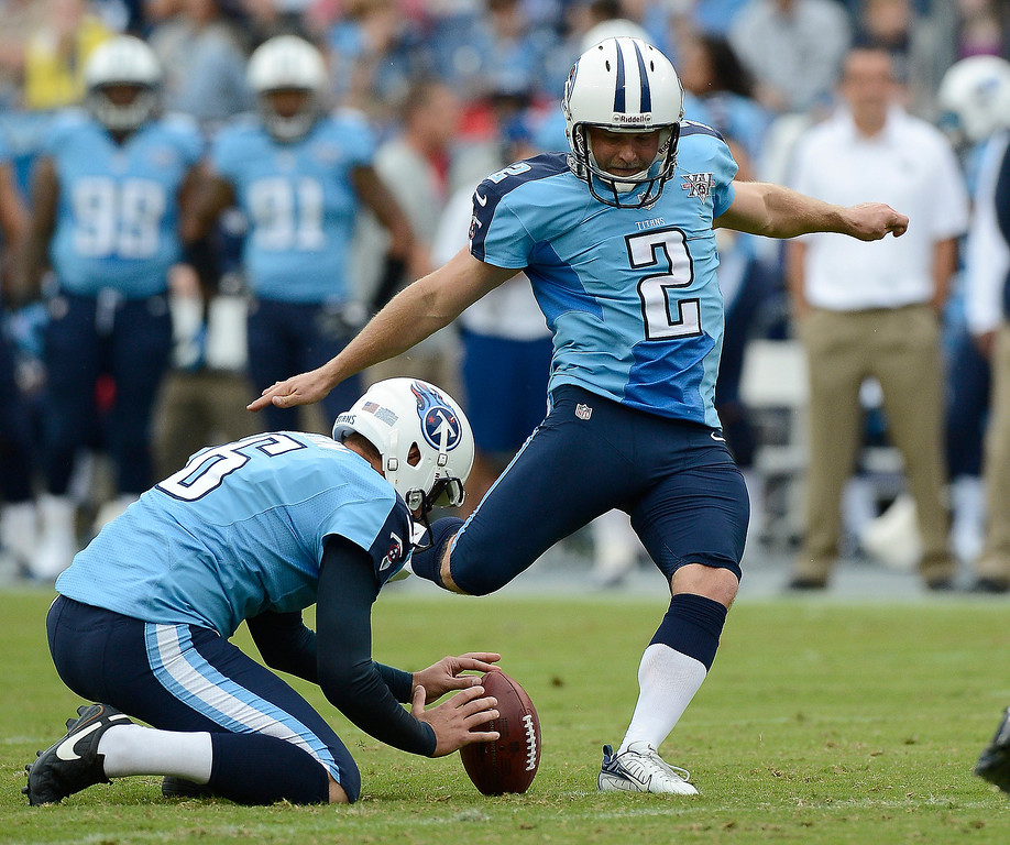 . Tennessee Titans kicker Rob Bironas (2) kicks a 26-yard field goal against the New York Jets in the first quarter of an NFL football game on Sunday, Sept. 29, 2013, in Nashville, Tenn. Holding is Brett Kern (6). (AP Photo/Mark Zaleski)