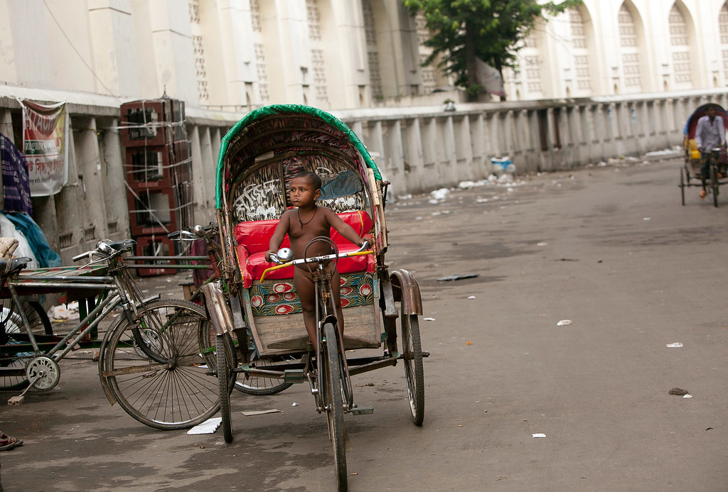 . A young boy stands on a rickshaw outside the National Mosque during Eid-Al-Adha on October 16, 2013 in Dhaka, Bangladesh.  (Photo by Getty Images/Getty Images)
